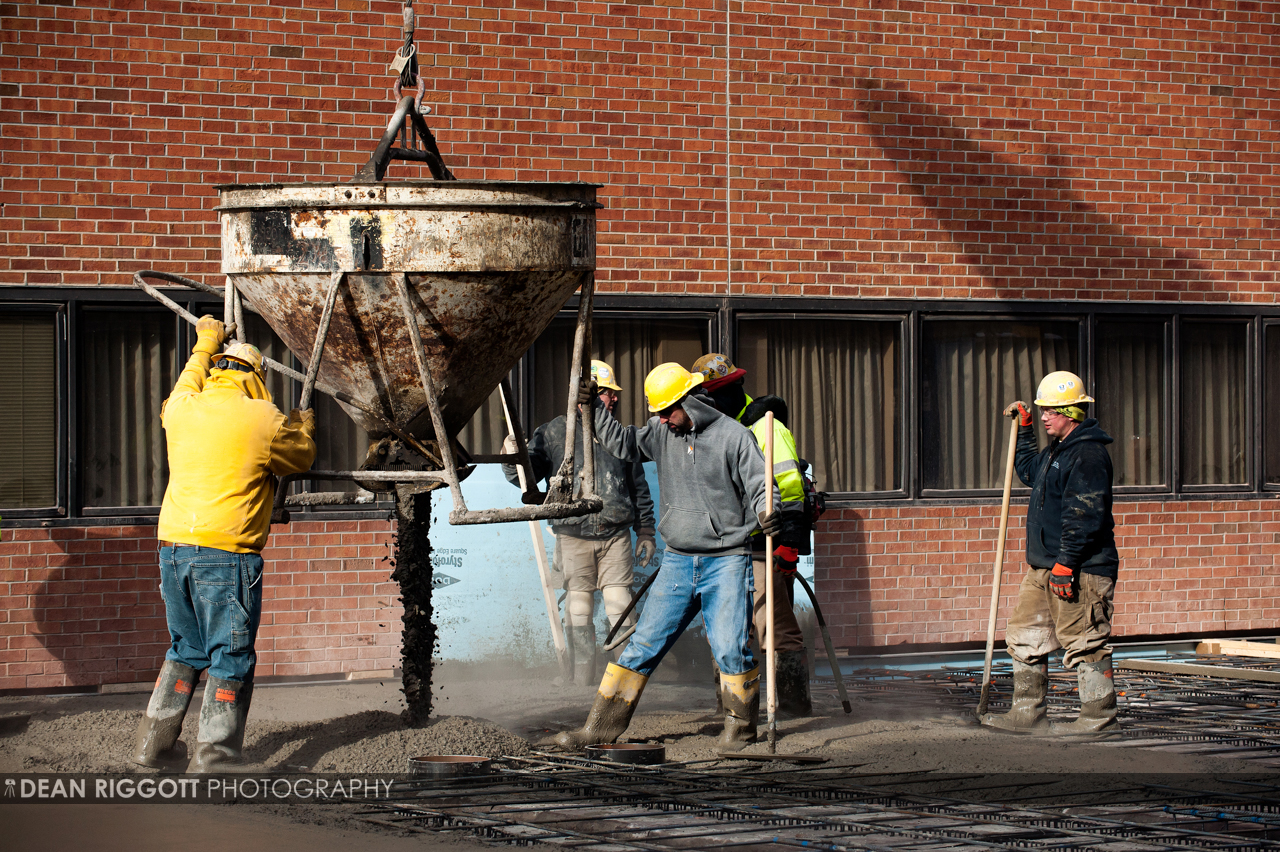 Workers pour and spread cement on the patio area between the old Mary Brigh building and the new tower Knutson Construction is building at the Mayo Clinic Hospital St Marys Campus in Rochester, Minnesota.