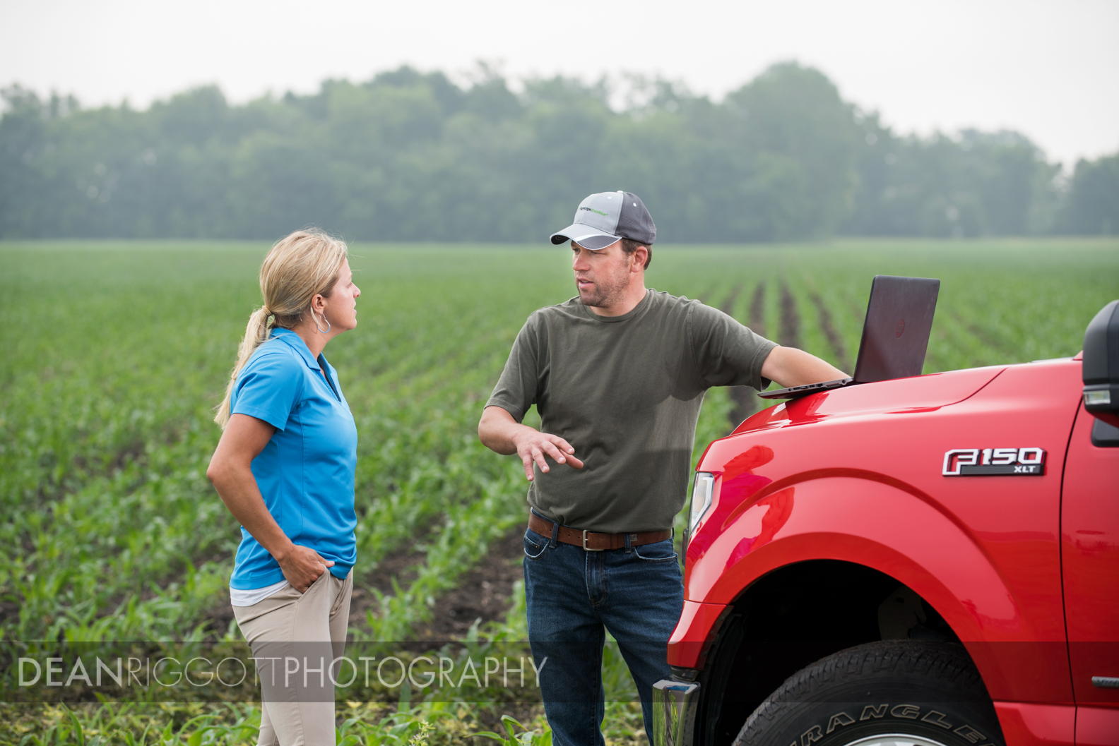 Talking in the field with Erin Goebel, a precision specialist with Central farm Service.